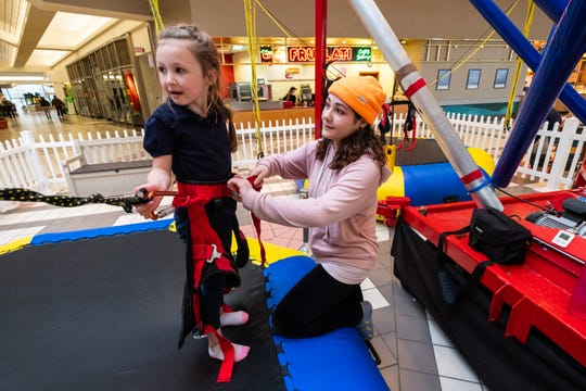 Tess Bacheller, who operated Zero Gravity in the Birchwood Mall, helps Kynlee Franzer, 5, out of a harness Friday, Jan. 31, 2020. Zero Gravity's last day of business was Jan. 31.