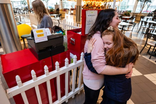 Tess Bacheller, who operated Zero Gravity in the Birchwood Mall, hugs  Khyla Franzer, 8, Friday, Jan. 31, 2020. Khyla and her sister Kynlee Franzer, 5, visited Zero Gravity frequently until it closed Jan. 31.