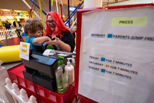 Sarah Smith, who operated Zero Gravity in the Birchwood Mall, plays with her son Simon Brown, 1, Friday, Jan. 31, 2020.