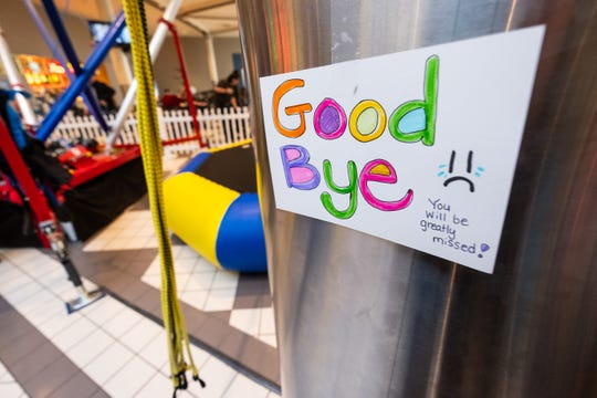 A sign is taped to a post at Zero Gravity ahead of closing Friday, Jan. 31, 2020, in the Birchwood Mall.