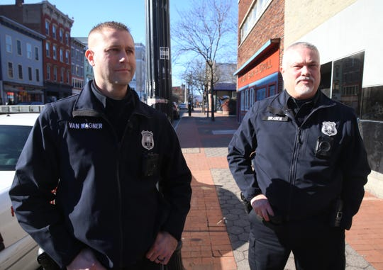 City of Poughkeepsie Police officers, from left, Kevin Van Wagner and Mike Braren wear a body cameras while patrolling Main Street on February 03, 2020.