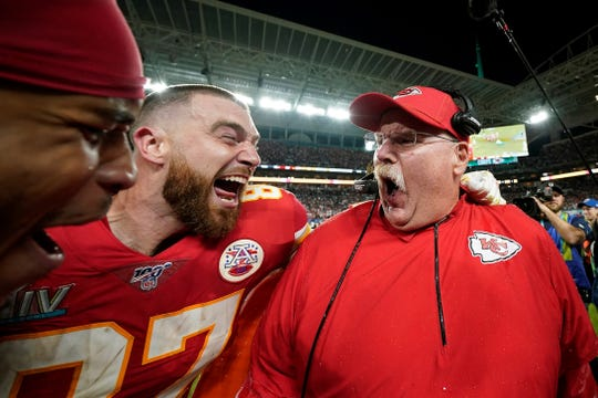 Kansas City Chiefs' Travis Kelce, left, celebrates with head coach Andy Reid after defeating the San Francisco 49ers in the NFL Super Bowl 54 football game Sunday, Feb. 2, 2020, in Miami Gardens, Fla. (AP Photo/David J. Phillip)