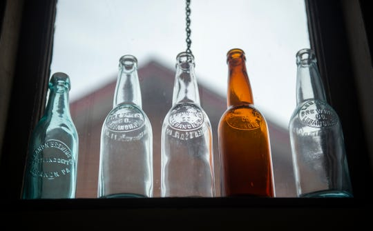 Pre-Prohibition era bottles sit on the window still inside the offices at Lebanon Valley Craft Brewery.