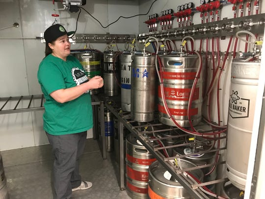 Ashley Johnson, founder of Local Beer Works, explains the custom draft system that helps ensure beer quality and flavor.