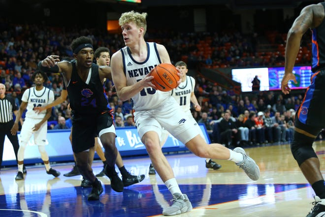 Feb 1, 2020; Boise, Idaho, USA; Nevada Wolf Pack forward Zane Meeks (15) drives during the first half versus the Boise State Broncos at ExtraMile Arena. Mandatory Credit: Brian Losness-USA TODAY Sports