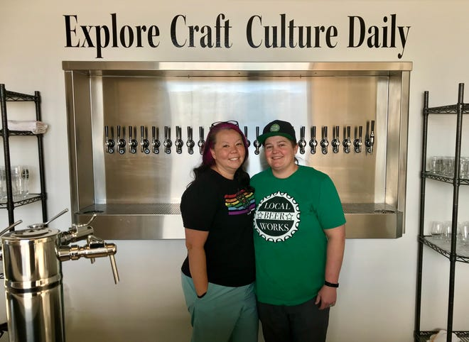 Ashley Johnson, right, founder and brew doyenne of Local Beer Works, and partner Tina Nielsen, who handles the crafting side of things at the store.