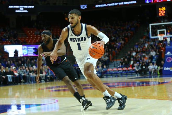 Nevada forward Robby Robinson drives to the basket against Boise State last season.
