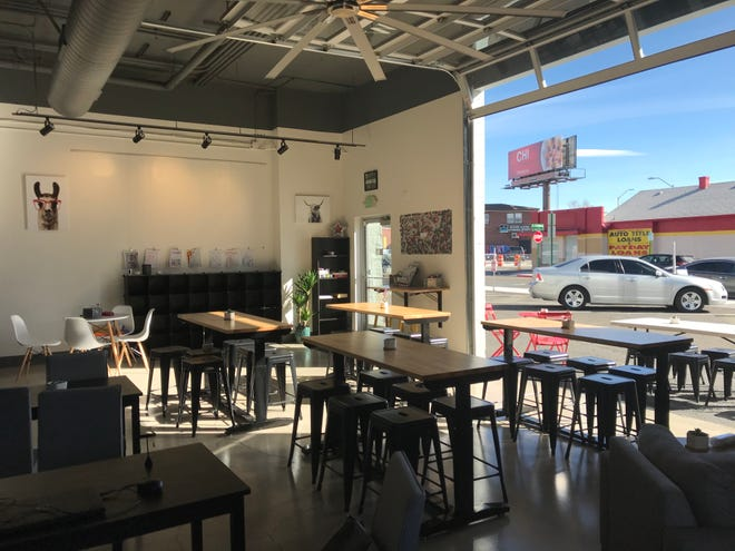 A glass roll-up garage door joins outside and indoors at the new Local Beer Works in Midtown Reno.
