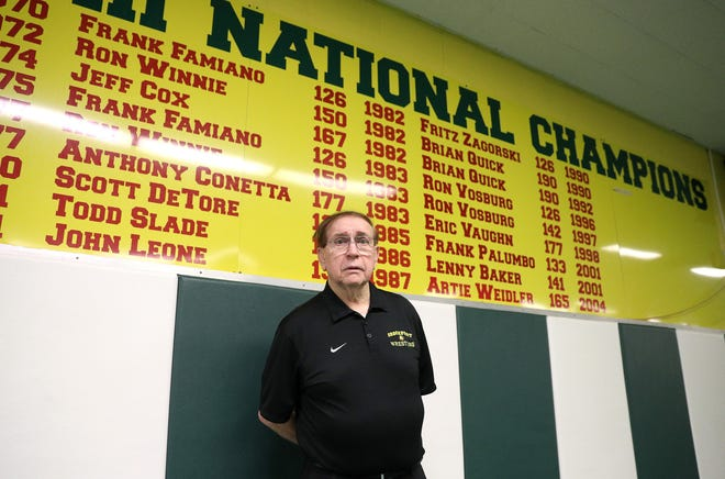 Don Murray has spent more than 50 years as coach of the SUNY Brockport wrestling team and has amassed a wall full of 27 national champions and 143 All-Americans.