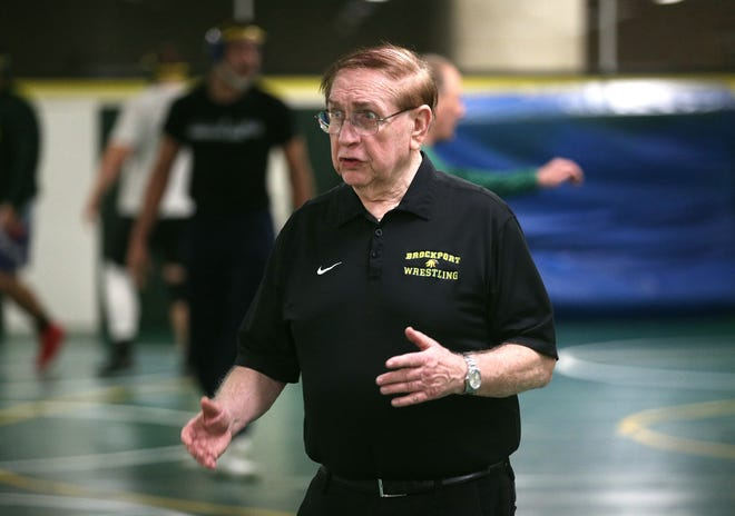 SUNY Brockport wrestling coach Don Murray running a practice in 2020.