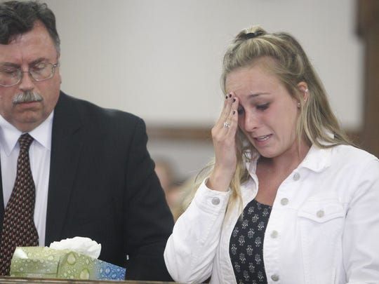 File Photo: Ontario County District Attorney R. Michael Tantillo stands next to Alexandra Gelinas as she gets emotional during part of her victim impact statement.
