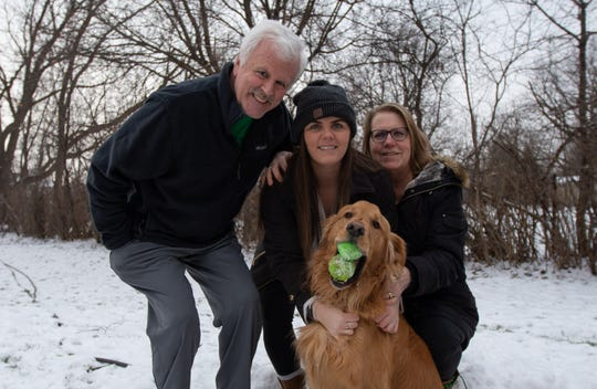 From left: Rob Molloy, Erin Molloy and Cheri Molloy with their dog, Finley, at their home in Canandaigua on Saturday, Feb. 1, 2020.