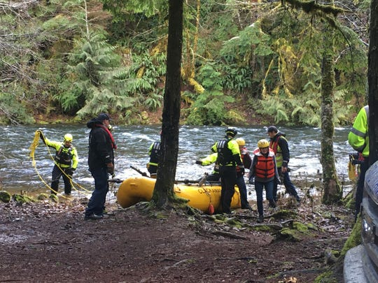 Two paddlers were rescued after their raft capsized Sunday on the Clackamas River near Austin Hot Springs.