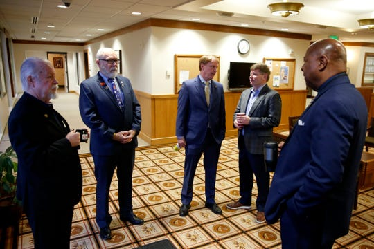 Sen. Chuck Riley, D-Hillsboro, from left, Sen. Arnie Roblan, D-Coos Bay, Sen. Tim Knopp, R-Bend, Dan Jarman, with Crosswater Strategies, and Sen. James Manning, D-Eugene, chat outside their offices on the first day of the short legislative session at the Oregon State Capitol in Salem on Feb. 3, 2020.