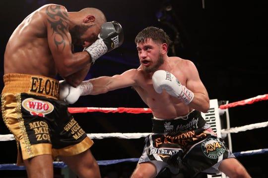 Salinas champion Ruben Villa (right) lands a hit on opponent Alexei Collado. Jan. 31, 2020.