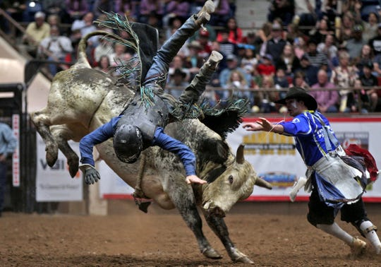 Parker McCown is thrown from a bull during the Xtreme Bulls event st the San Angelo Stock Show and Rodeo on Sunday, Feb. 2, 2020.
