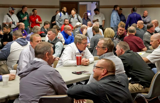 High school football coaching staff members gather at the Region 15 Service Center in San Angelo for the UIL realignment on Monday, Feb. 3, 2020.
