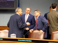 Commissioner of Administration Jay Dardenne, the governor's chief budget adviser, left; House Speaker Clay Schexnayder, R-Gonzales, center; and Senate President Page Cortez, R-Lafayette, speak ahead of a meeting of Louisiana's income forecasting panel on Friday, Feb. 7, 2020, in Baton Rouge, La. (AP Photo/Melinda Deslatte)