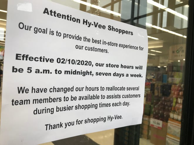 A sign posted on the door of Hy-Vee announces hour changes in Sioux Falls.
