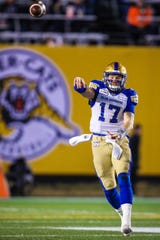 Winnipeg Blue Bombers quarterback Chris Streveler (17) throws ball against the Hamilton Tiger-Cats in the first half during the 107th Grey Cup championship football game at McMahon Stadium.