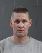 Ian Avery, 38, was arrested Jan. 31 in connection with the theft of 21 firearms.