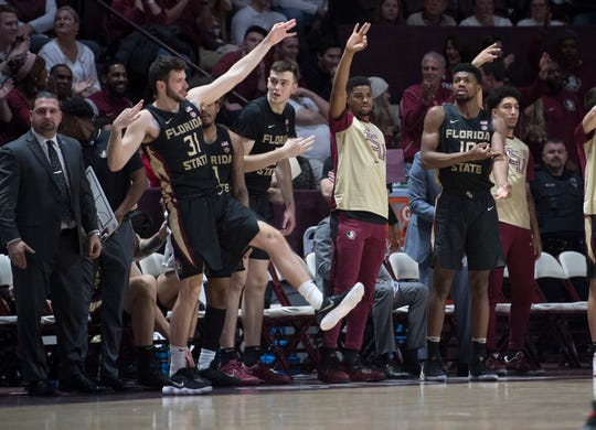 Florida State bench celebrates another three pointer against Virginia Tech during the second half of an NCAA college basketball game in Blacksburg, Va., Saturday, Feb. 1, 2020. (AP Photo/Lee Luther Jr.)