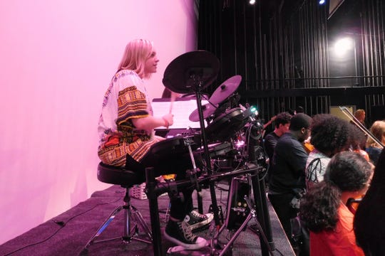 Tenth-grader Rose Sembler has taken up the drums to play in Lincoln's rock ensemble.