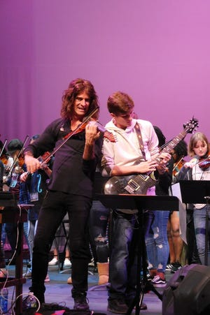 """Carter Nelson and Mark Wood perform """"Enter Sandman"""" by Metallica at Lincoln High School."""