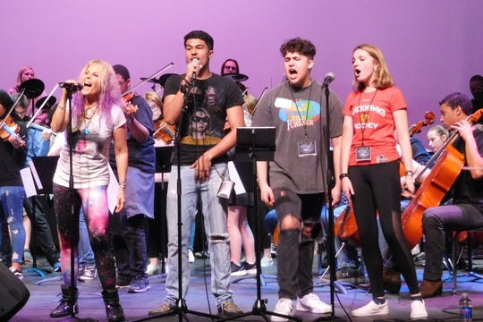 "Vocalist Laura Kaye coaches students on ""Sweet Child of Mine"" at Lincoln High School."