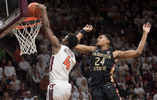Virginia Tech guard Nahiem Alleyne (4) dunks in front of Florida State defender Devin Vassell (24) during the second half of an NCAA college basketball game in Blacksburg, Va., Saturday, Feb. 1, 2020. (AP Photo/Lee Luther Jr.)