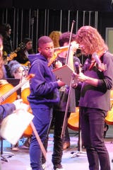 "Lincoln students got to play unusual instruments like ""Viper"" electric violins which Mark Wood invented."