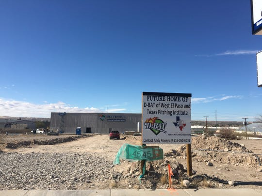 A sign on the West Side promotes the coming of D-Bat of West El Paso and Texas Pitching Institute.