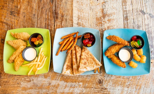 Items from the kids menu at Two Chefs Cafe and Market include chicken fingers, a cheese quesadilla, and cod fingers.