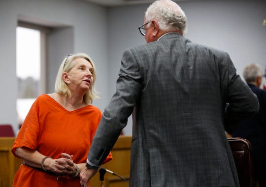Cindy Schulz-Juedes talks with defense attorney Earl Gray after her arraignment on Monday, Feb. 3, 2020, at the Marathon County Courthouse in Wausau, Wis. Schulz-Juedes pleaded not guilty to a charge of first-degree intentional homicide for the 2006 death of her husband, Kenneth Juedes.