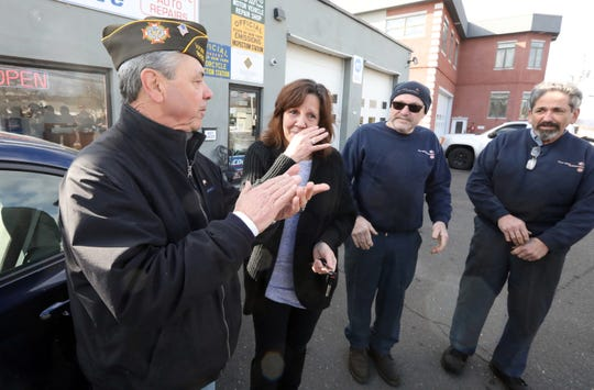 Carolyn Fugate, a veteran from Pomona, picks up the car that was donated to her at Four Star Auto in Monsey Feb. 3, 2020. Guy Gebbia of the VFW, left, Fugate, Four Star Auto owners Dave Davidowicz and Irwin Weisman, FourFour Star did repairs on the car.