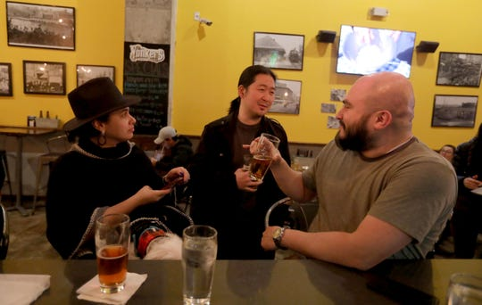 Lizbeth Carrero of Ardsley, Daywon Choi of Yonkers, and Josue Galdamez of the Bronx sit at the bar at Yonkers Brewery Jan. 31, 2020. Choi, who moved to Yonkers five years ago, after living in midtown Manhattan, feels that Yonkers is not an ideal city for single people because things are too spread out, and that even with all the new development, there's not enough to attract enough people.