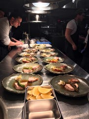 """Chef Anthony Gonçalves inspects the pork saddle before serving it as part of a 7-course """"Dinner with Jeanne"""" at Kanopi in White Plains Jan. 30, 2020."""