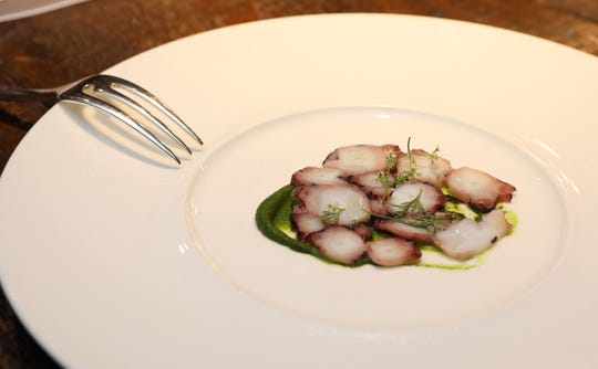 Octopus served with black olive and coriander blossoms at Kanopi Restaurant, atop the 42nd floor of the Ritz-Carlton Westchester in White Plains.