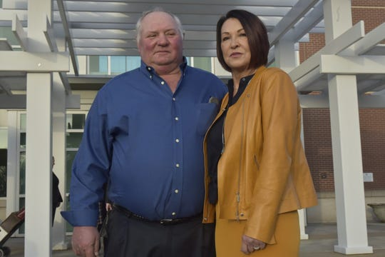 Bill Bader, owner of Bader Farms, and his wife Denise pose in front of the Rush Hudson Limbaugh Sr. United States Courthouse in Cape Girardeau, Missouri, on Monday, Jan. 27, 2020.