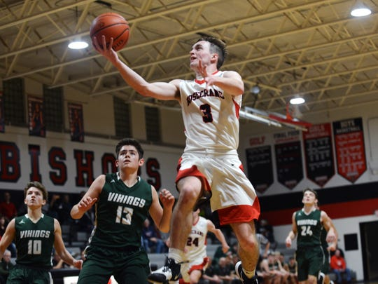 Rosecrans senior Paul Nern soars through the lane for a layup against Johnstown Northridge on Jan. 15, 2020 at Rogge Gymnasium. The Bishops were ranked fourth in Division IV on Monday by the Associated Press.