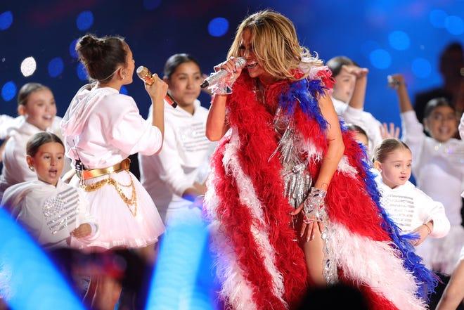 Jennifer Lopez performs along with her daughter Emme Maribel Mu–iz during the Super Bowl LIV Halftime Show.