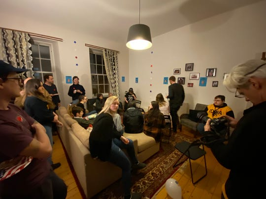 Twenty Iowans showed up to participate in the first ever satellite caucuses in an apartment in Glasgow, Scotland Monday.