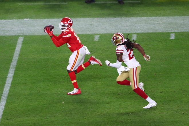 2020: Kansas City Chiefs wide receiver Sammy Watkins (14) hauls in a 38-yard pass as San Francisco 49ers cornerback Richard Sherman (25) gives chase in the fourth quarter. Watkins caught five passes for 98 yards in the Chiefs' 31-20 win.