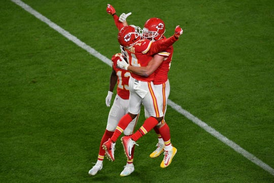 Chiefs tight end Travis Kelce, right, and wide receiver Sammy Watkins celebrate a fourth-quarter touchdown in Super Bowl LIV.