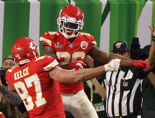 Kansas City Chiefs tight end Travis Kelce (87) celebrates with Chiefs running back Damien Williams (26) after scoring a touchdown in the fourth quarter.
