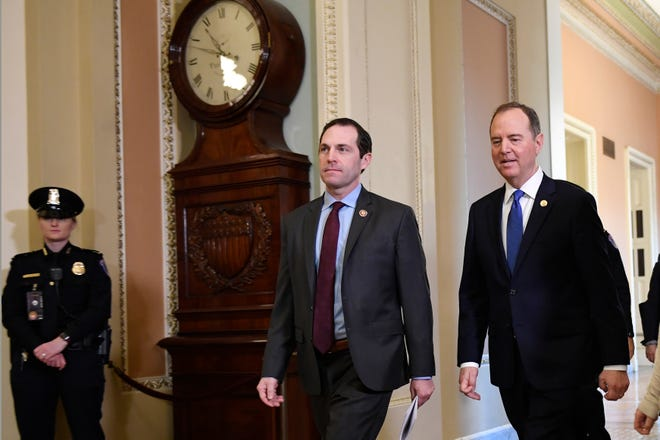 House Democratic impeachment managers Rep. Jason Crow, D-Colo., center, and Rep. Adam Schiff, D-Calif., right, arrive at the Senate on Monday for the impeachment trial of President Donald Trump