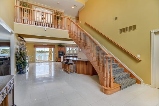Inside features a majestic two-story foyer