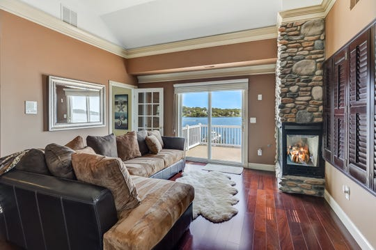 The Family room has a stone gas fireplace and hardwood flooring.