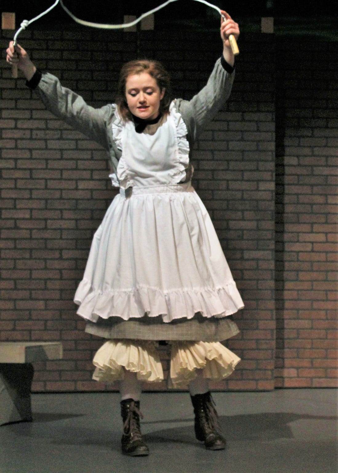 """Mary (Maddie Lowry) jumps rope outside after arriving in England from India in this rehearsal scene from """"The Secret Garden."""""""