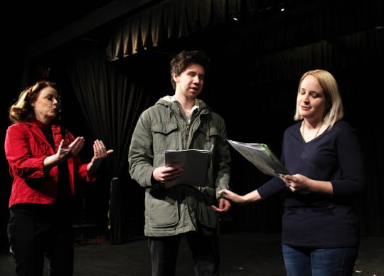 """Puck (Elise Pryor-Harden) directs her actors Lysander (Christian Jay) and his lover Hermia (Ginger Vinson) as they rehearse a scene for Puck's play in this rehearsal scene in """"Midsummer"""" by ACT."""